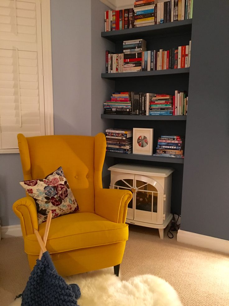 Yellow IKEA Strandmon chair against Little Greene Juniper Ash and Pale Wedgewood paint. Cosy reading corner.