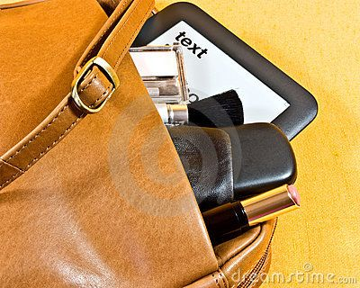 A real leather ladies shoulder bag, containing a mobile phone, makeup and an ebook with text