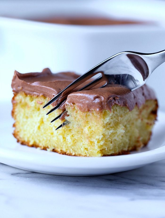 This is the easiest and softest sour cream cake ever. My family asks for it again and again and the chocolate frosting is easily the creamiest I ever had!