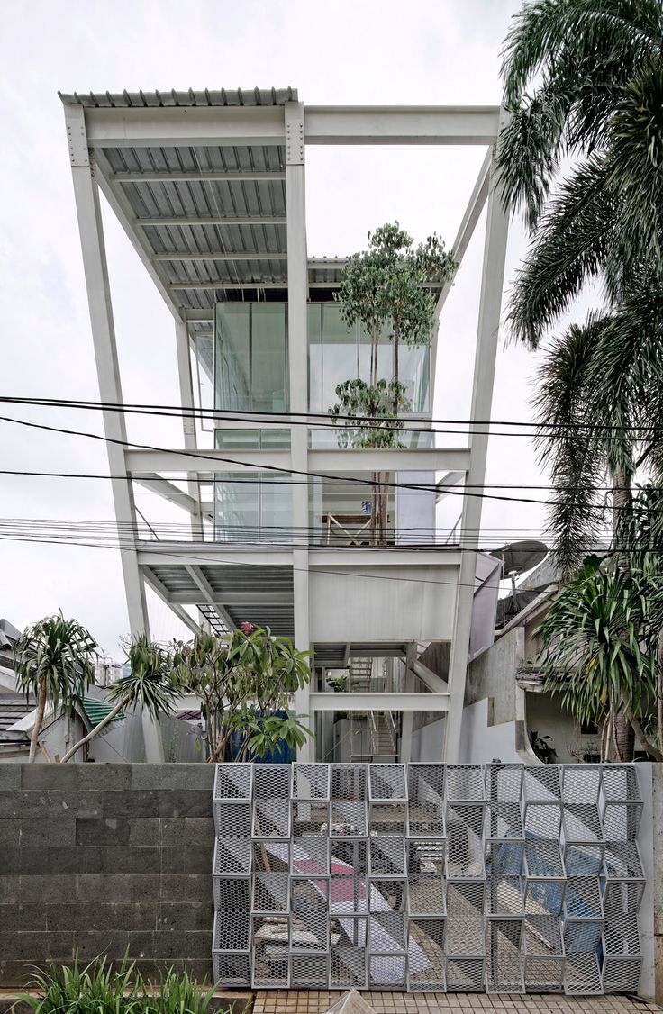 House design indonesian style - Budi Pradono Completes Leaning House In Jakarta