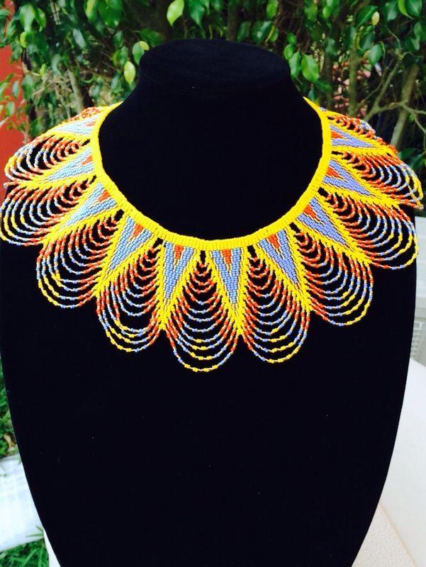 Handmade beaded zulu necklace. Follow us on social media @Femmes Royales