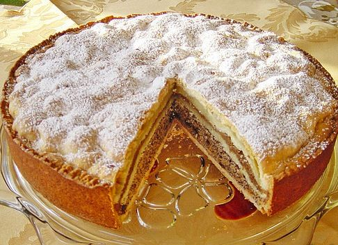 The German New Years Cake is a traditional cake with 3 layers of different fillings: poppy seeds, nuts and apple. This is an original German proven recipe. You might ask yourself why is this a new years cake? Tradition and popular belief says that poppy and nuts are supposed to bring health and good luck to the home. That is a good reason to get started. Happy Baking!