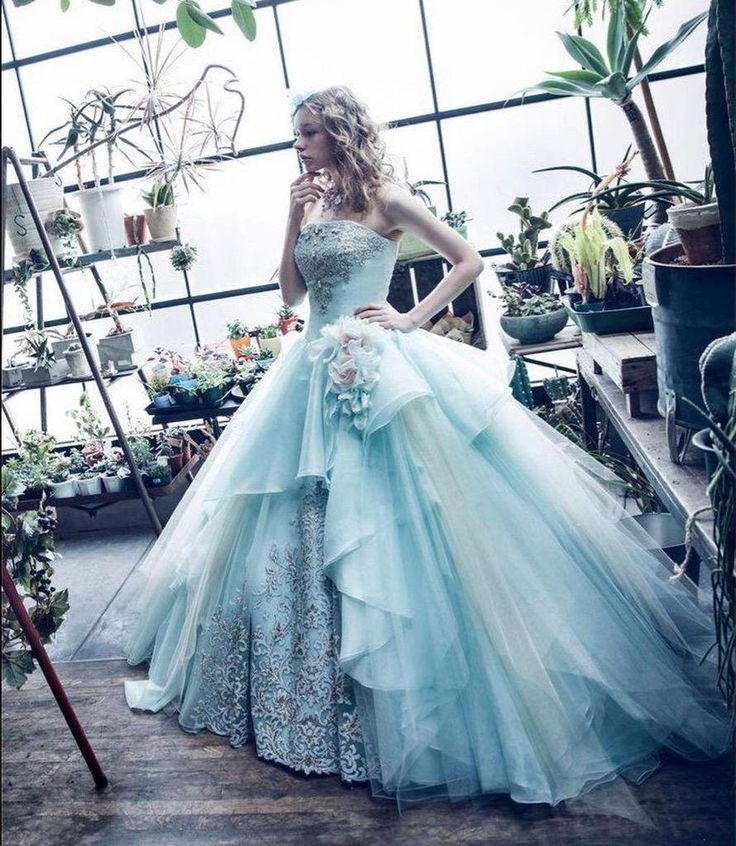 Light blue ball gown, layered skirts, embroidery and beading.