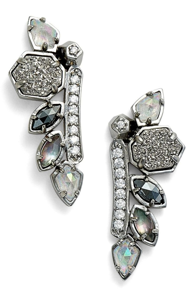 Moody dark crystals and iridescent drusy create sparkling glamour on these dramatic ear crawlers that are designed to rest against the length of the earlobe.