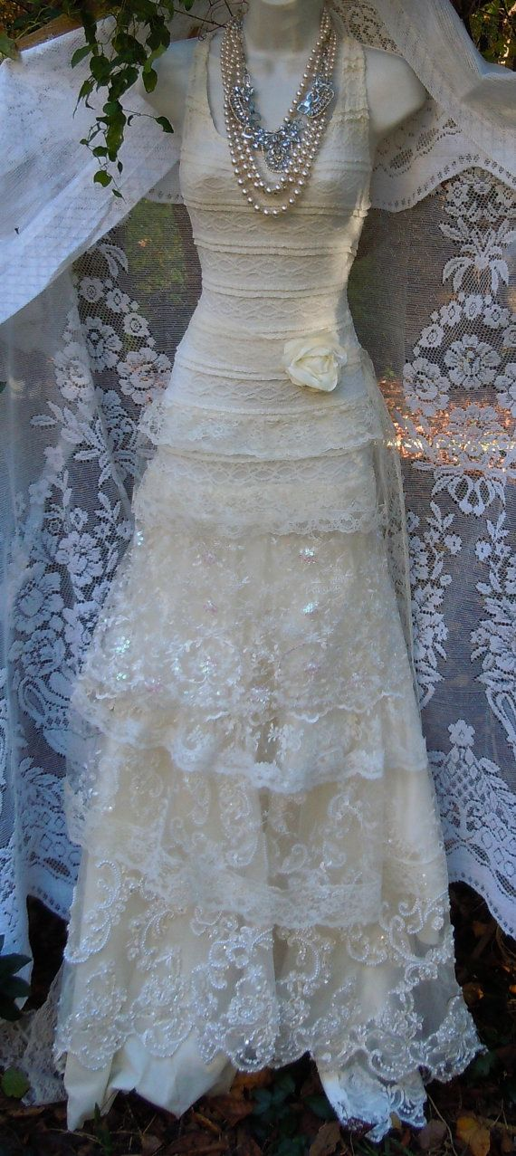 Cream wedding dress handmade by vintage opulence on Etsy  The top is a soft cream lace with lining, sleeveless with a vintage lace sash The skirt