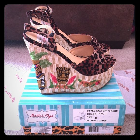 """Authentic Bettie Page Rockabilly Platforms NWT Bettie Page Rockabilly Platforms. Shoes by Ellie. Style#BP475-KEKE. """"Tiki leopard""""4.5 inch platform. Purchased in April 2015 at the Viva Las Vegas Rockabilly Show in Las Vegas, NV. Size 9 Also available on Mercari Bettie Page Shoes"""