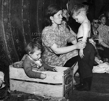 Family in underground shelter during air raid, September 1940