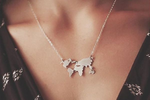 This beautiful minimalist world map necklace will look great with any outfit. Don't miss out on the statement accessory