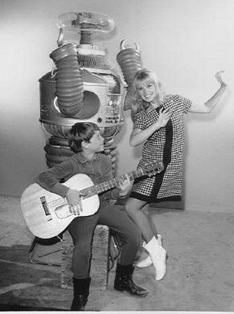 The B9 robot, in a publicity photo with Marta Kristen and Billy Mumy, as it appeared in the first season of the 1960's TV series, Lost in Space.