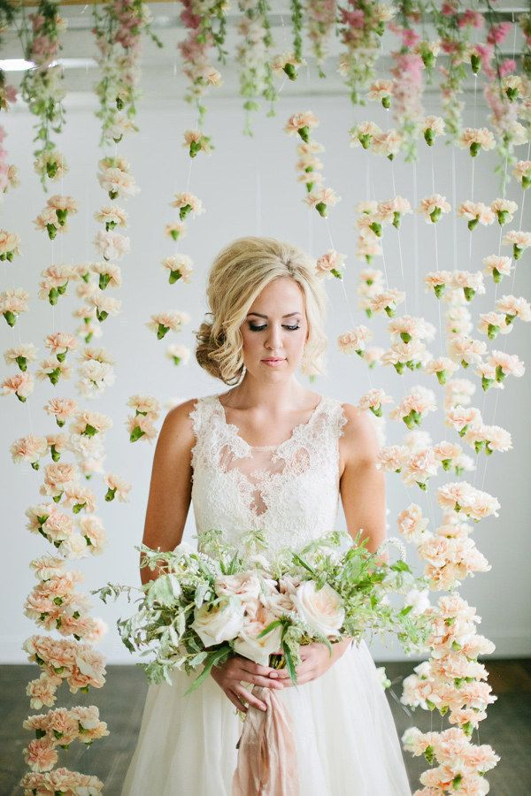 This literal curtain of carnations. | 21 Incredibly Gorgeous Wedding DIYs That You Can Actually Do