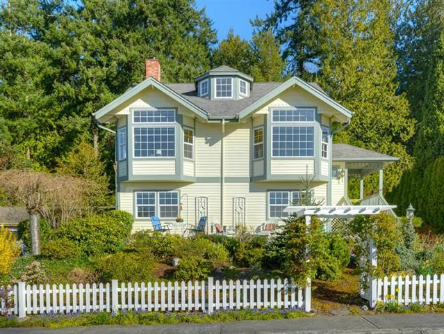 Price Reduced! Jump on this rare opportunity to own a charming Poulsbo home with an outstanding view of Liberty Bay and the marina. This not too big not too small just right house exudes European charm. Light and bright youll appreciate the sensible floor plan. The dining area and living room feature high ceilings and are the perfect place to relax and enjoy the scenery. Almost every room has a view. The garden has an abundance of flowers Spring through Fall.