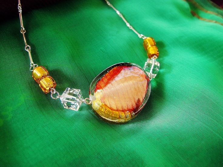 """""""The Patatina""""   Large potato chip shape Murano glass bead in rose, green and topaz tone with sterling silver necklace.  Find her at: http://nutsiya.etsy.com"""