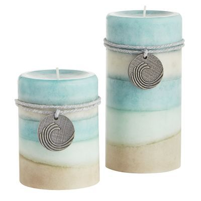 Enjoy a coastal breeze even when you're far inland with our own blend of jasmine, white lilac and gardenia, with just a splash of peach, in textured, hand-molded candles with decorative medallions. Keep for yourself or give them as gifts.