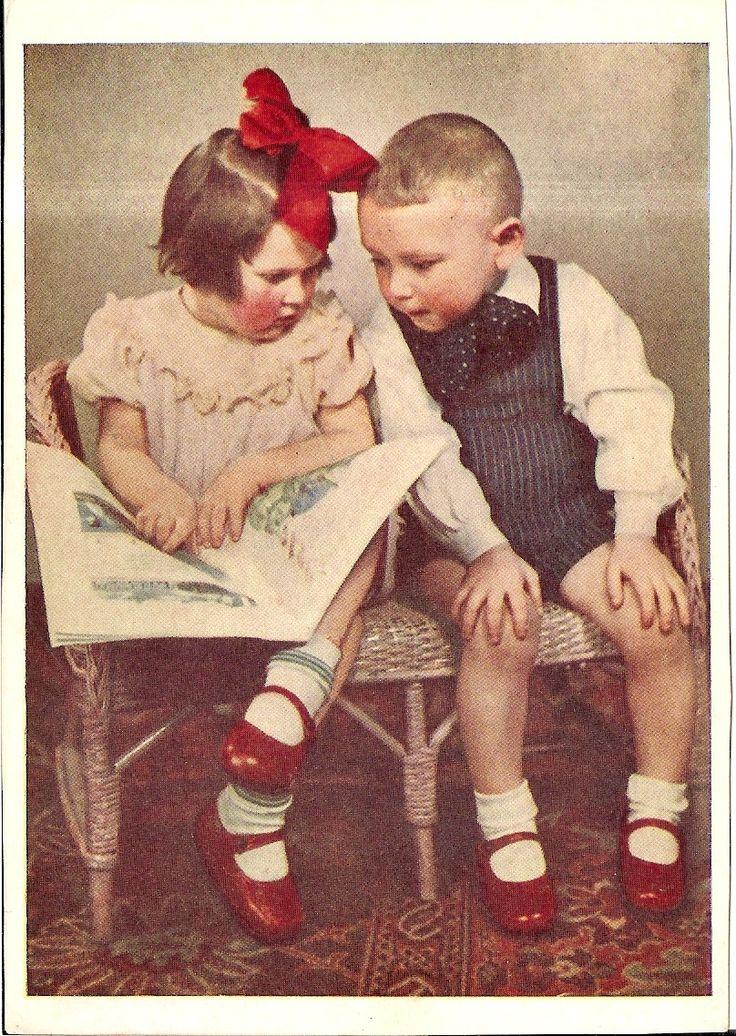 children sharing a book (russian postcard)