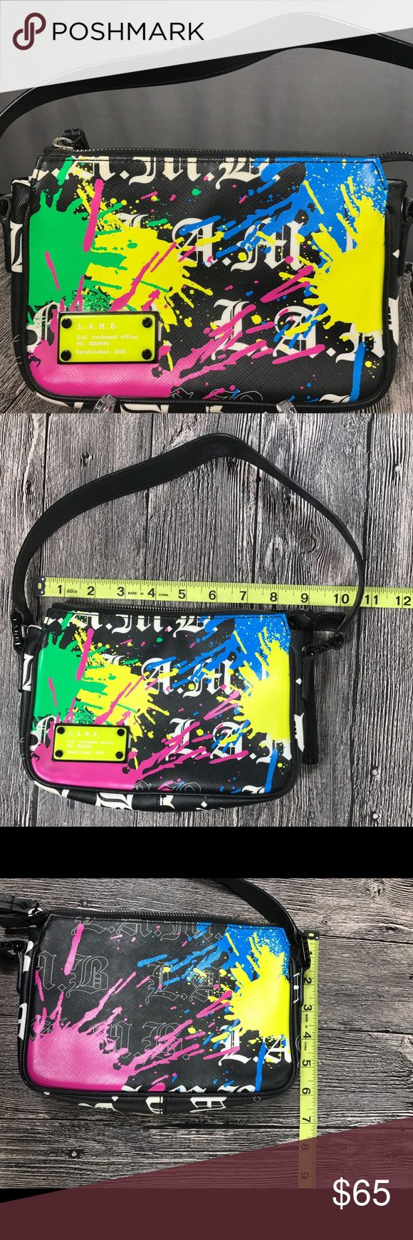 """L.A.M.B. Baron Spectral Shoulder Bag L.A.M.B. Baron Spectral Shoulder Bag Rare Baron style LAMB bag in the Spectral print, black background with L.A.M.B. logo print in white and neon paint splatters in pink, blue, green, and yellow. Zip closure, interior features one small zip pocket. Size: 8.5"""" Wide x 6"""" High x 2""""L; Drop of 6.5"""" in Excellent condition. Visit my closet to see matching wallet! L.A.M.B. Bags Mini Bags"""