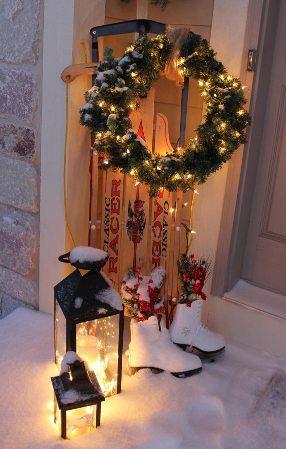 My front door Christmas decorations. I do think the snow tops off my sled display!