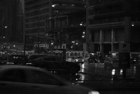Racism Is Structural in Canada and Academia. #racismisstructuralincanada #blackandwhitephoto #bw #torontophoto #torontolife #landscape #crossroad #trafficlights #cars #powerlines #signs #sidewalk #night #nightlife #torontonightlife #torontonights #lights #rainy #rainyday