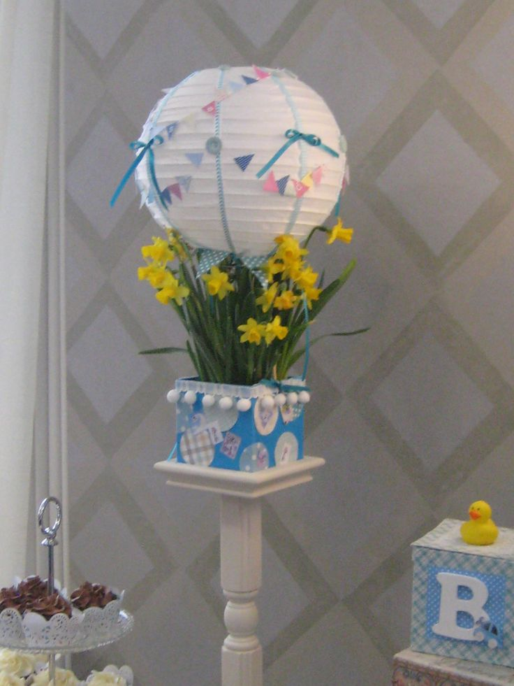 Hot air Balloon flower arrangement. Bunting taken from cake bunting.  Paper lantern glued to $ box that I decorated