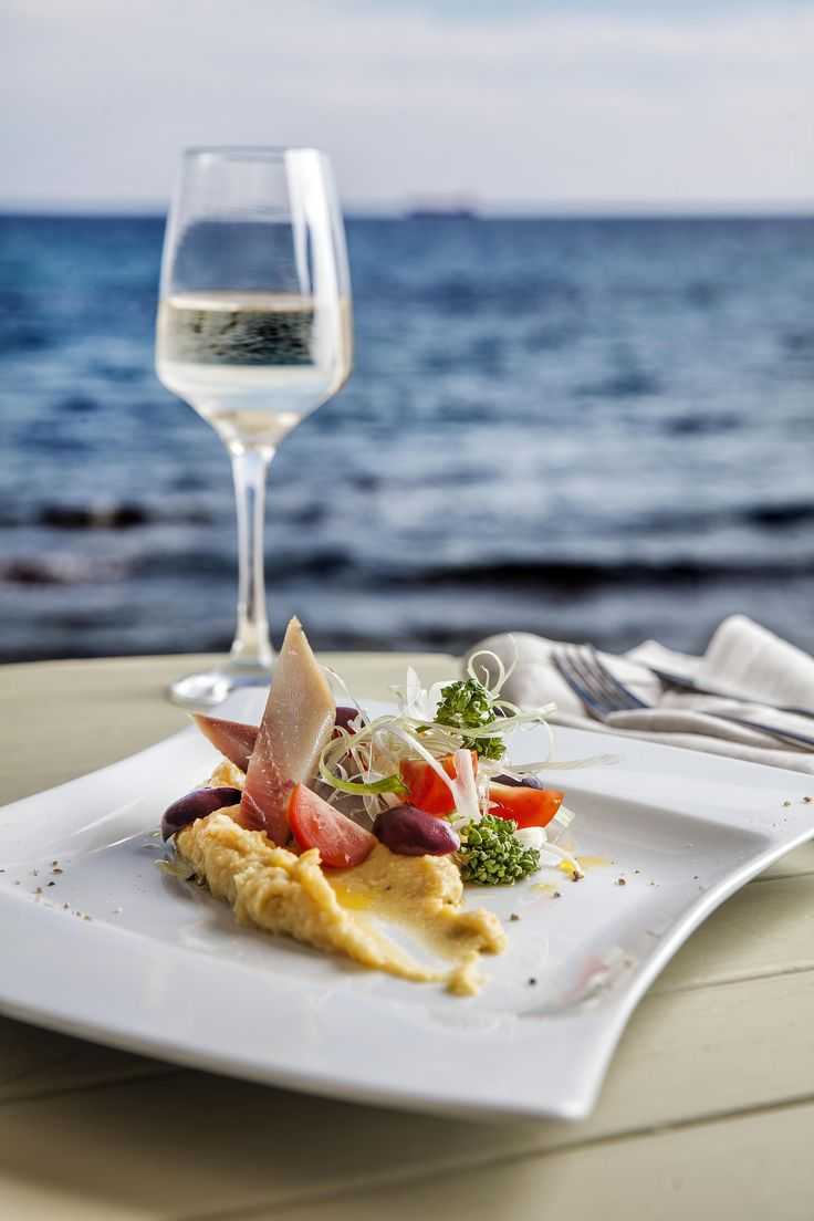 "Red lentil Greek ""fava"" with spring onions, cherry tomatoes and fillet of smoked herring by Aelia Beach Bar Restaurant."