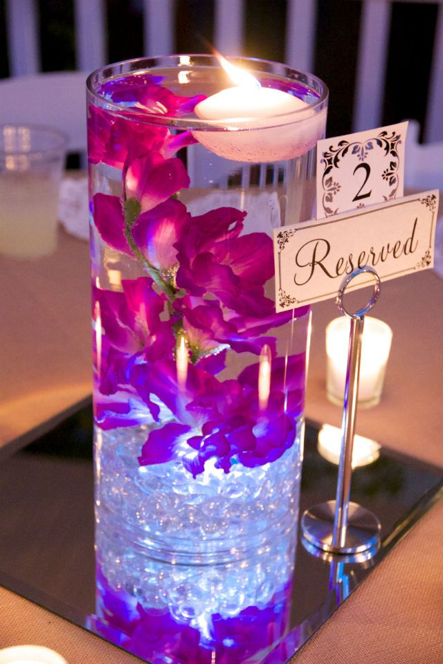 Best 25 water centerpieces ideas on pinterest rainbow for How to make flowers float in vases