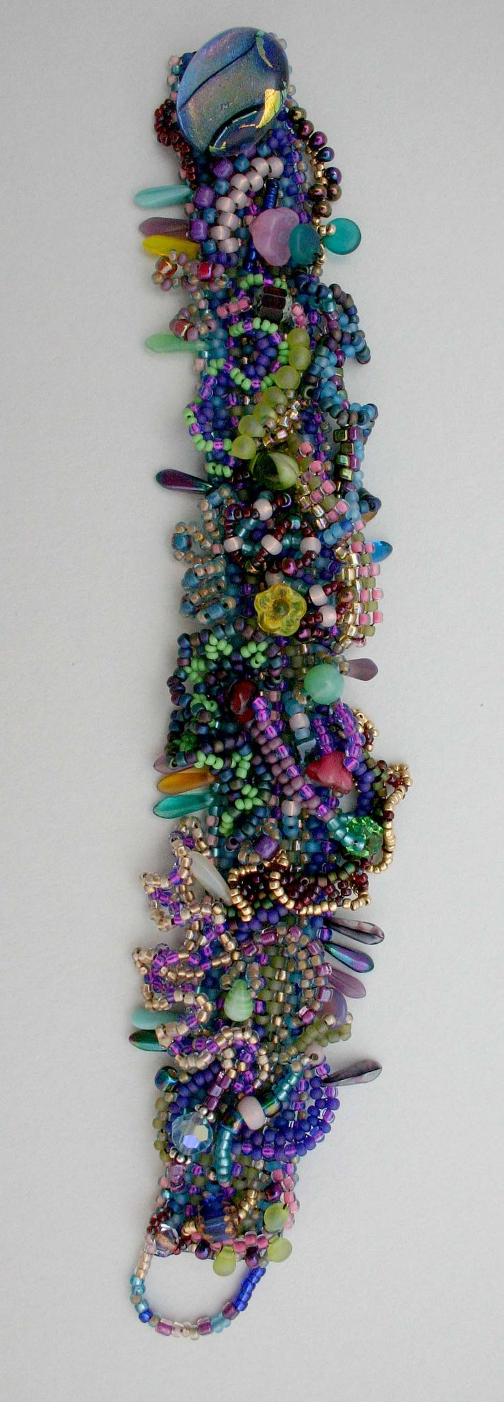 Details of one of my drop stitch peyote freeform bracelet.