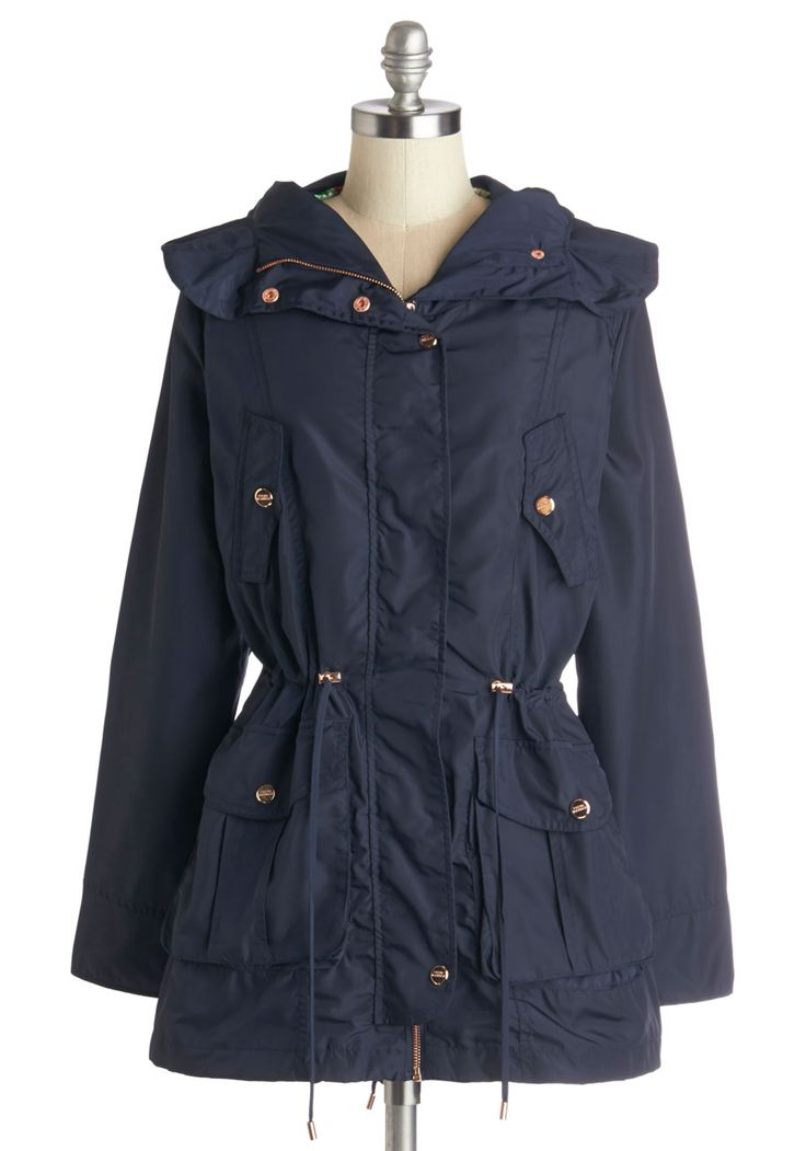 Walk the Rainway Raincoat. Its a misty morning for a walk to the docks with your family, so you flip up the hood on this lightweight navy blue raincoat, tighten the drawstrings around your waist, and head towards the shore. #blue #modcloth