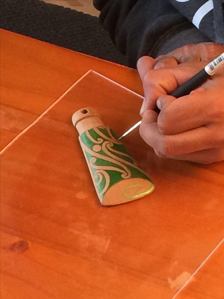 Toki pendant made from Rimu hand painted kowhaiwhai