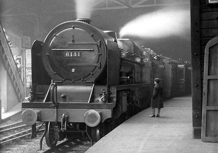 LMS 6P Royal Scot Class 4-6-0 No 6131 'The Royal Warwickshire Regiment' is seen standing at New Street station