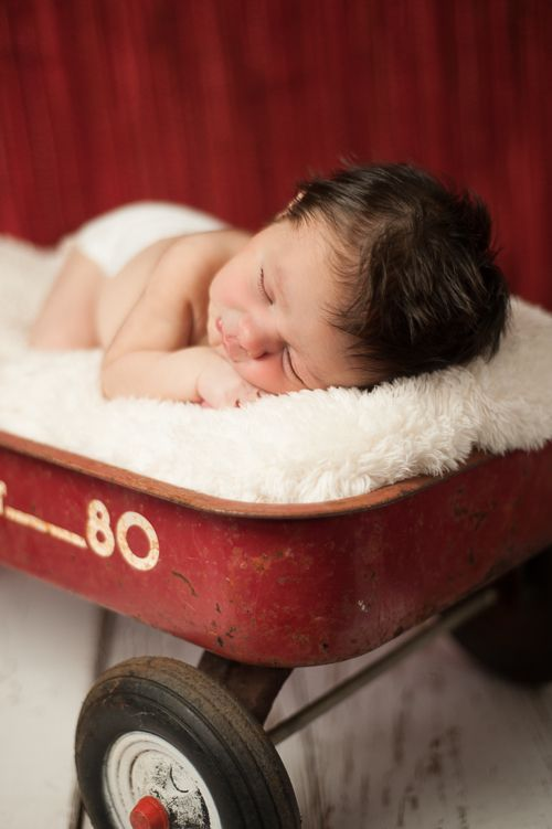 newborn boy in antique red wagon - Tavia Larson Photography - Mechanicsburg, PA - in home newborn photography