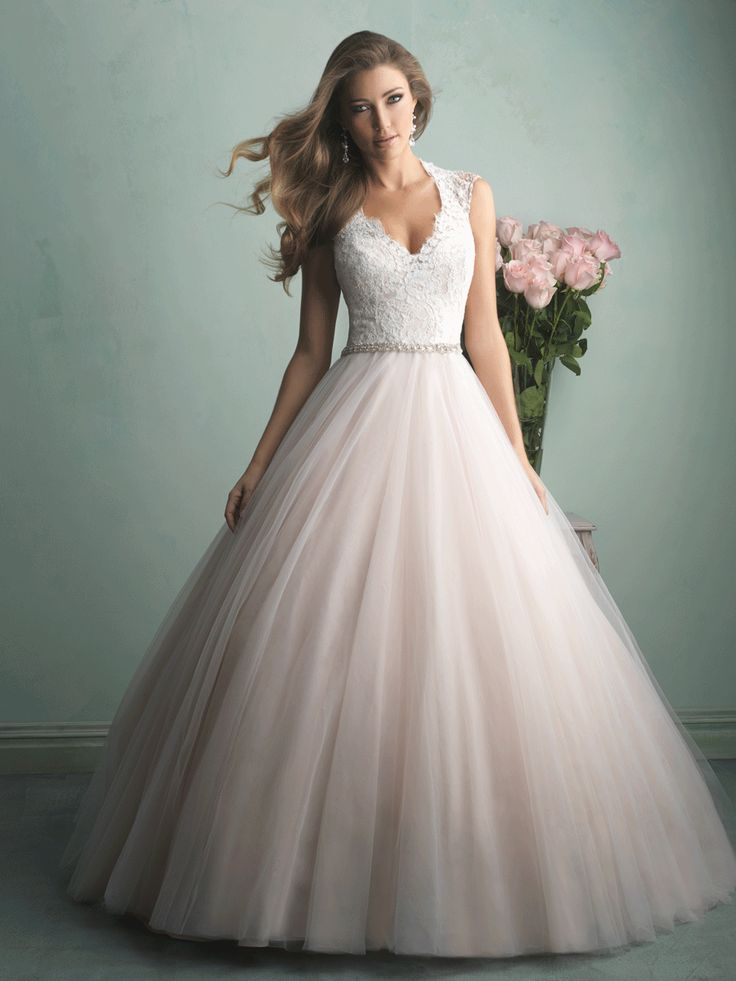 This is truly the ballgown of a princess — a gauzy tulle skirt topped with an incredibly gorgeous lace bodice and a sheer, beaded back.  Allure Bridals (9062)