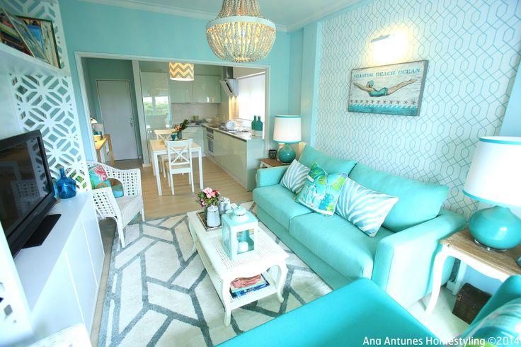 coastal inspired, beach house, seaside inspired, turquoise blue, aqua blue, turquoise sofa, aqua blue kitchen, small open plan living room, small spaces, canovas fabric, tropical pillows, geometric rug, geometric wallpaper