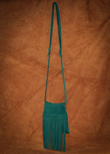 Original Fringe Purse. This style comes in turquoise, black, brown, cream, pink, red, and saddle tan.