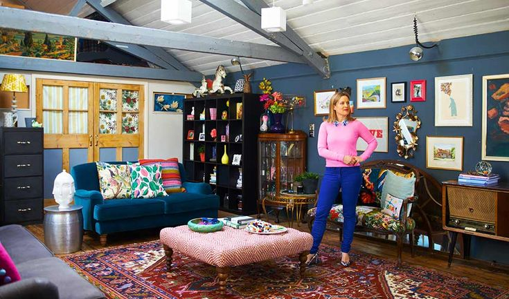 Sophie standing in her brightly coloured living room.