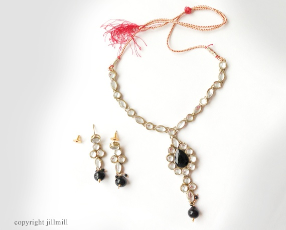 A mix of round and oval kundans along with black stones and beads looks incredibly sleek and chic.