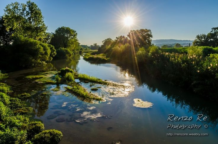 Sunset on the River by Renzo Re