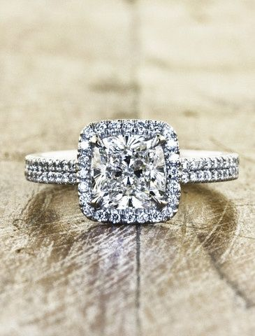 Cushion cut diamond halo wedding ring.