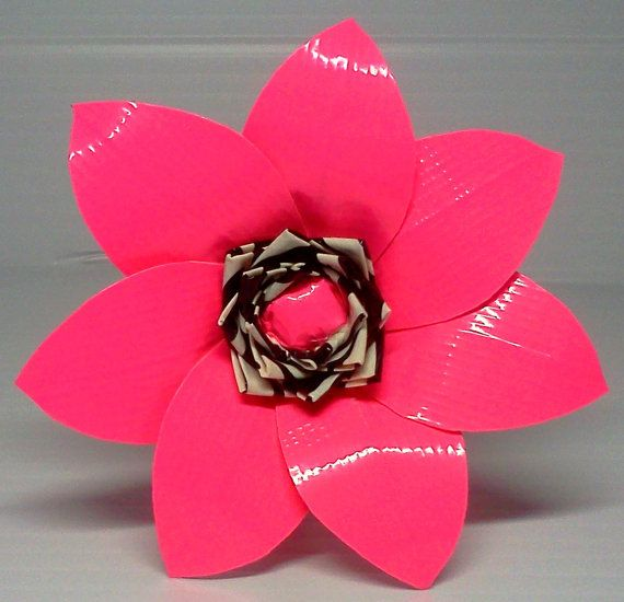 Duct Tape Flower Pen... I just bought new, funky duct tape today for a different project, but I might have to try this as well.