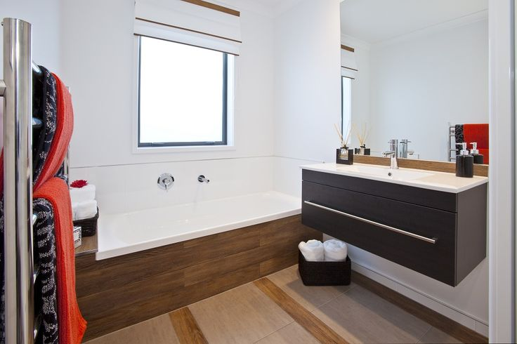 Different coloured wood adds interest to this main bathroom.