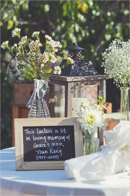 Memory tables are very popular at funeral. What a great and affordable idea to use chalk boards to describe what is on the table. In this case they wrote that the lantern was lit in loving memory of the departed. #funeral ideas, #celebration of life ideas, #memory table, #creative funeral ideas