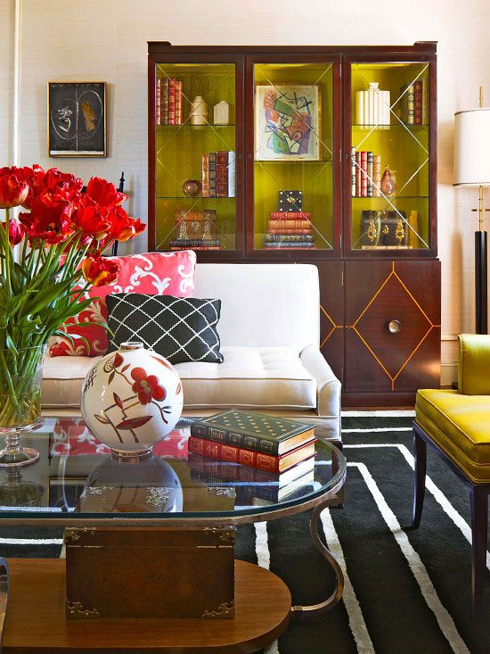 Fashion-Forward Palette    A navy-and-white rug, featuring a motif of concentric rectangles, steals the show in this large master bedroom suite. The rug's graphic pattern complements the sleek lines of the modern furniture. Bold accessories in colors such as coral and chartreuse emphasize the rug's deep navy hue.