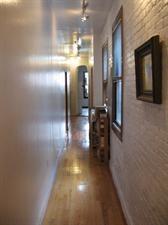 narrow hallway design idea. Great for those Brooklyn Brownstone hallways.