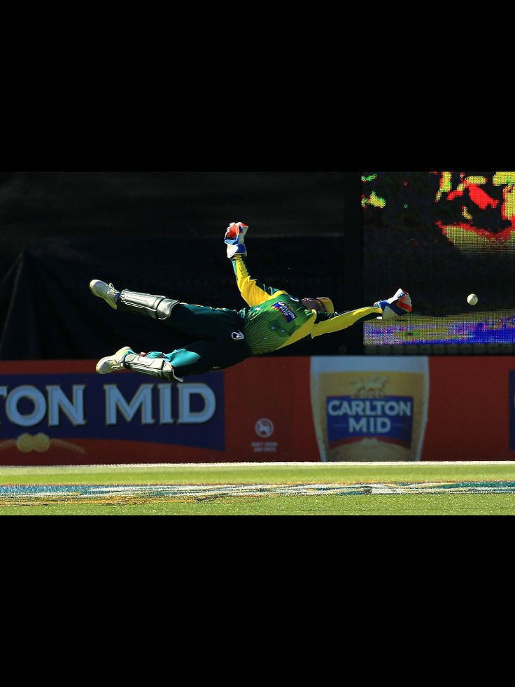 Australian Cricket wicketkeeper Matthew Wade diving to catch/stop a ball.
