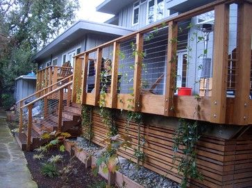 """Under the deck space... similar idea to the """"alternating width plank horizontal fence"""". A little planter edging at the bottom before a step down to ground level. Only looks like 8 steps high though. http://www.houzz.com/photos/127524/Portola-Valley--CA-modern-landscape-san-francisco#"""
