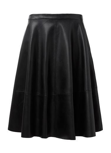 Pu Faux Leather Circle Skirt. Comfortable yet neat fitting style features a full circle skirt, fixed waistband with zipper opening and midi panel hem. Available in Black as shown.