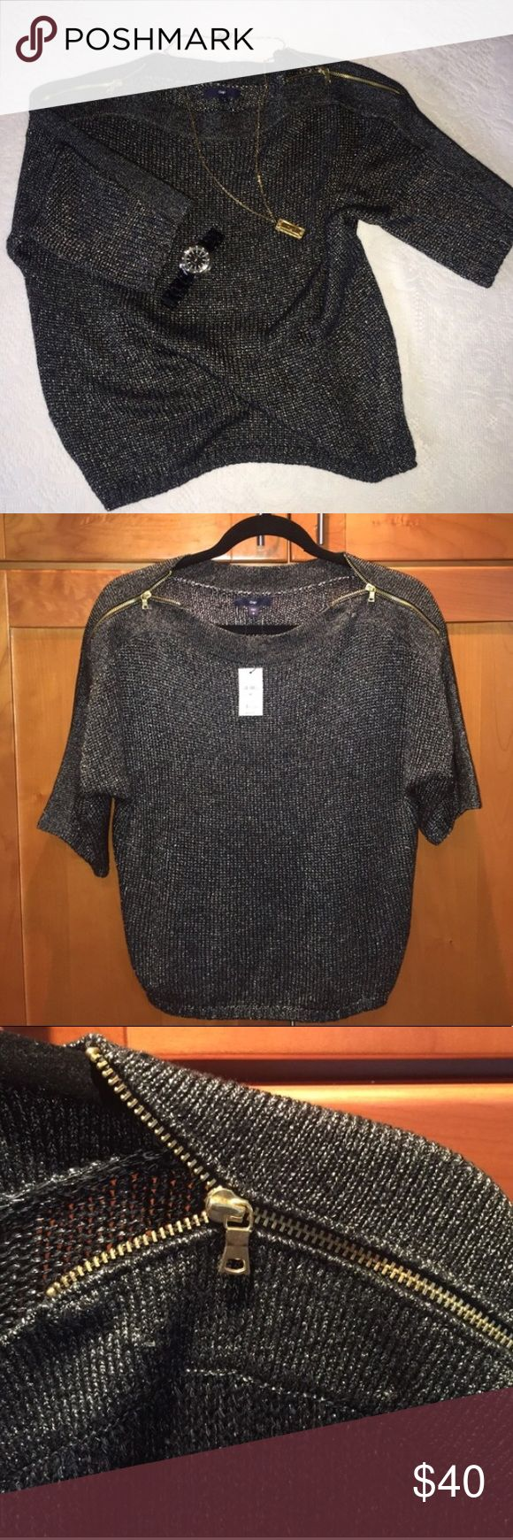 Gap Sweater Women's Size M NWT Brand New With Tags. Size M GAP Short Sleeve Sweater Top. Working Gold Zippers on Shoulders. 74% Acrylic 26% Nylon. Has some areas where yarn is pulled out a little (see 3rd pic under zipper) but this seems to be the nature of the material. Super soft | Open to offers! :) ✅ Offers Welcomed ✅ Bundle & SAVE! (Add 1 time or more to a bundle & get private discount!)  🛃📦 📦 📦 Fast Shipping! 🚫 No Trades GAP Sweaters Crew & Scoop Necks