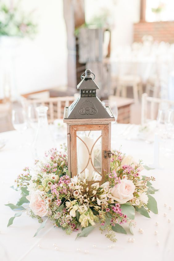 rustic wildflowers and wood lantern wedding centerpiece / http://www.deerpearlflowers.com/rustic-wedding-details-and-ideas/