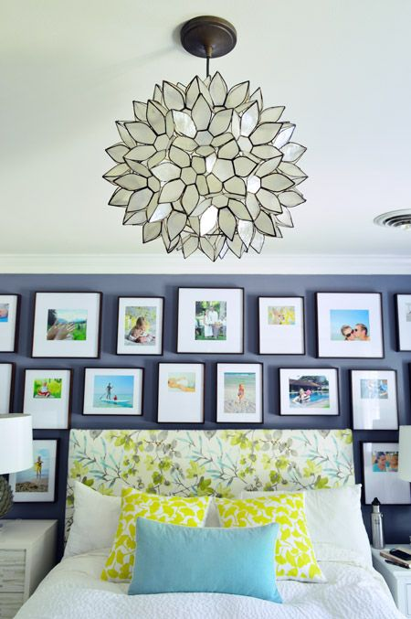 Another stunning #gallerywall from Young House Love. It's a symmetrical layout, but the way they've let the edges flutter up and down gives this display a lighthearted feel.