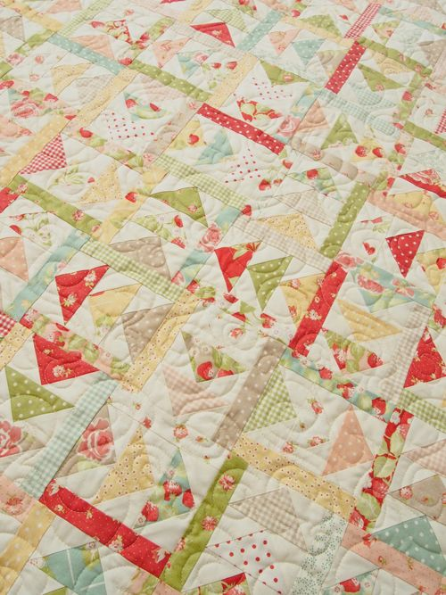 Scrap quilt from Fig Tree fabrics, pattern is Summer Day by Miss Rosie.