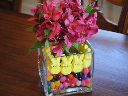 DIY Peeps and Jelly Bean Centerpiece. You could make a mini one using the heavy Dollar Store square glass votive holders/vases. From Flair for Home here.