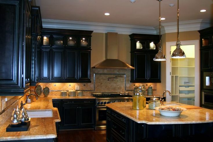colors of cabinets and counters paired with light tan walls